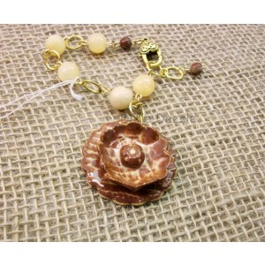 After Christmas sale. Ceramic flower bracelet with yellow jade.Stoneware clay charm by Dixie Dazzle, . One of a kind bracelet